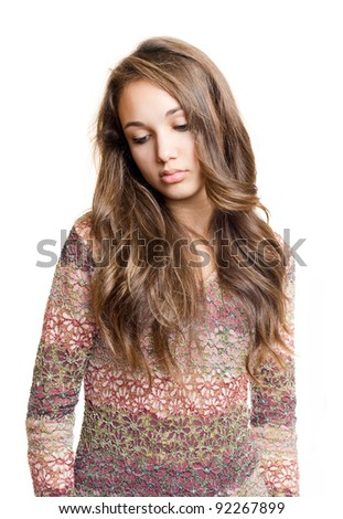 Emotional portrait of gorgeous  sad looking young brunette teen. - stock photo