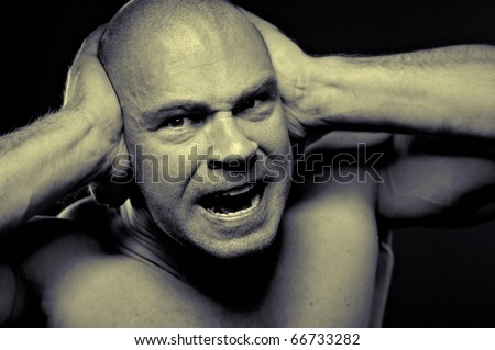 Emotional portrait of muscular aggressive man - stock photo