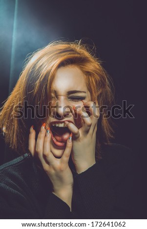 emotional portrait of red hair woman  in studio - stock photo
