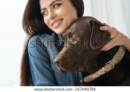 Emotional stunning woman hugging her loyal friend