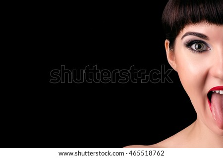emotional woman half face with tongue out