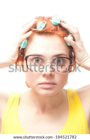 emotional young woman in curlers isolated on white background