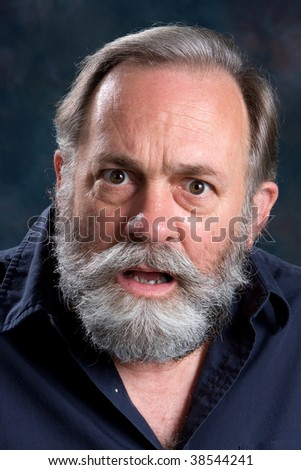 Emotionally charged man confronts with his feelings of injustice. - stock photo