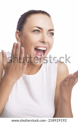 Emotions Concept: Portrait of Excited Caucasian Brunette Female Showing Positive Facial Expression. Isolated Over Pure White. Vertical Shot - stock photo