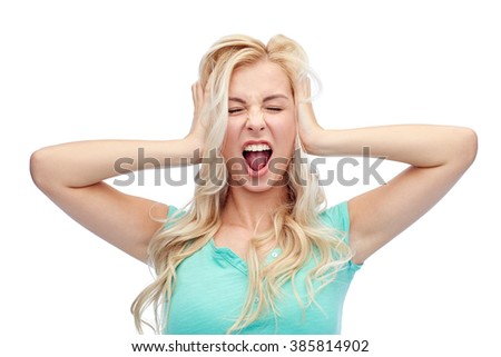 emotions, expressions, hairstyle and people concept - young woman holding to her head and screaming