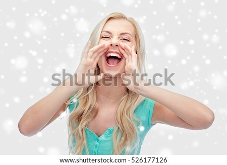 emotions, expressions, winter holidays, christmas and people concept - young woman or teenage girl shouting over snow