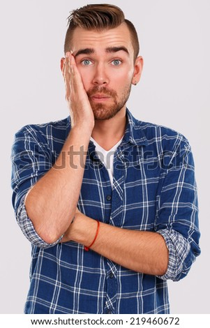 Emotions, feelings. Young guy with on a white background - stock photo