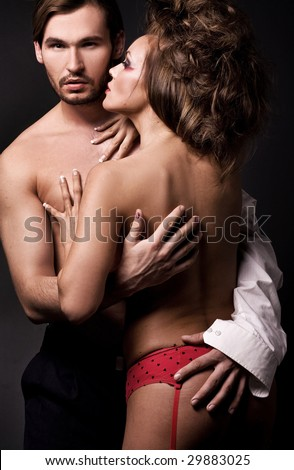 Emotive portrait of a young sexy couple - stock photo