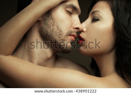 Emotive portrait of two lovers - handsome man and gorgeous woman with perfect hair and skin. Pure passion. Close up. Studio shot - stock photo