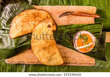 empanada is a stuffed bread or pastry baked or fried - stock photo