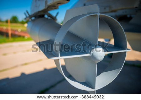empennage aviation bombs on a military bomber close-up - stock photo