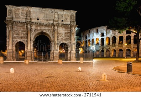 Emperor Constantine Arch and coliseum by night - stock photo
