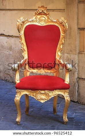 Emperor throne made with gold and red velvet - stock photo