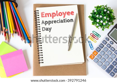 employee appreciation day text message on white paper and office supplies, pen, paper note, on white desk , copy space / business concept / view from above, top view - stock photo
