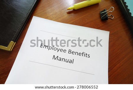 Employee Benefits Manual on an office desk                                - stock photo