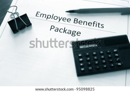 employee benefits package with calculator and pen - stock photo