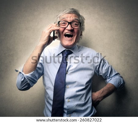Employee chatting on the phone  - stock photo