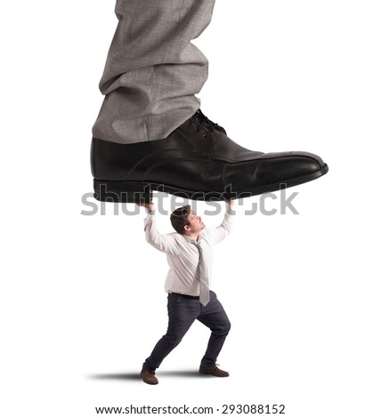Employee crushed by his boss at work - stock photo