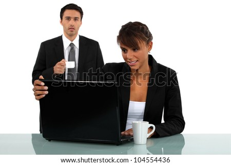 Employees having a coffee in office