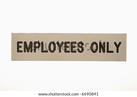 Employees only sign against white background.