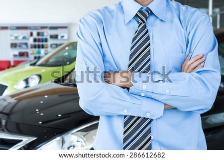 Employees Standing in front of car - stock photo