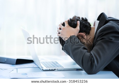 Employees to think and not Work with stress Pretending to put his hand to the head - stock photo