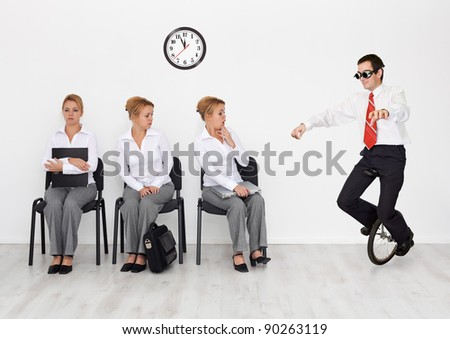 Employees with special skills wanted concept - man with monocycle - stock photo