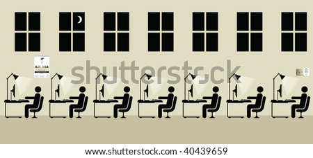 Employees working a late shift at the office - stock photo