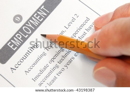 Employment Opportunity Classified Advertising with Human Hand Holding Yellow Pencil
