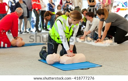 Empoli, Italy - 07 May 2016: The event is run in the square, doctors, nurses and volunteers welcome high school students for a course of first aid, also emergency vehicles on show. - stock photo