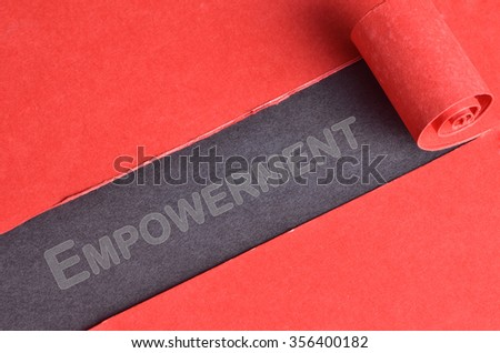 Empowerment word on top of torn red paper  - stock photo