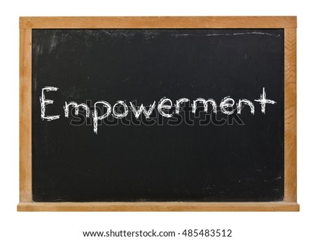 Empowerment written in white chalk on a black chalkboard isolated on white