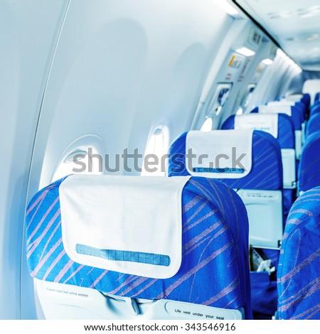 Empty aircraft seats and windows. - stock photo