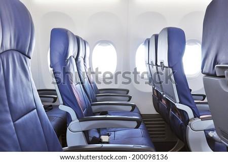 Empty airplane seats - stock photo