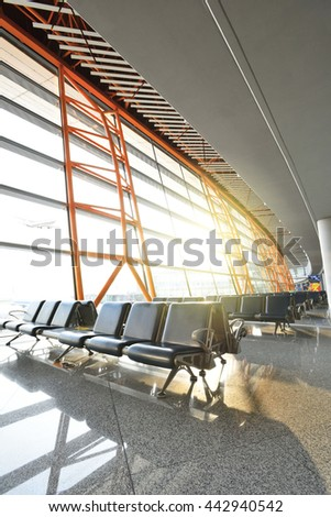 Empty airport terminal waiting area - stock photo