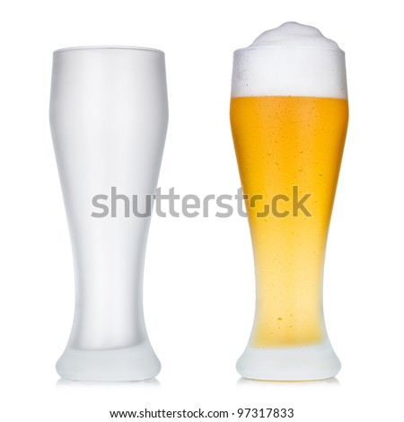 Empty and full beer glass - stock photo