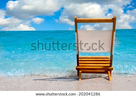 Empty and single chair at the beach.Selective focus on the chair  - stock photo
