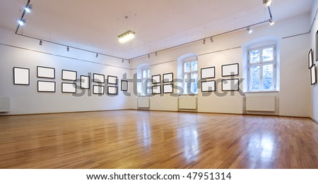 Empty art gallery view with blank pictures - stock photo