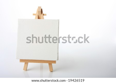 Empty artists canvas on an easel, shot on white, put your own message on it