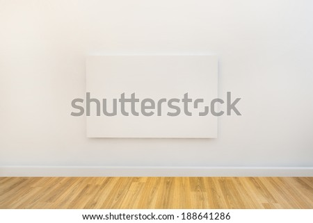 empty artwork ready for design to be added on white wall - stock photo