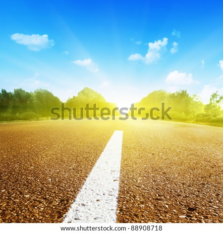 Empty asphalt road in sunshine. - stock photo