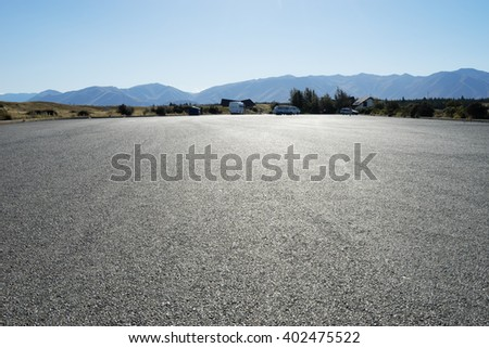 empty asphalt road near mountains in new zealand - stock photo
