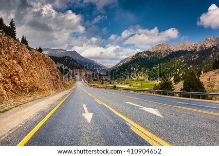 Empty asphalt road with dramatic cloudy sky. Beautiful outdoor scenery in Turkey, Asia. Image of travel concept background.