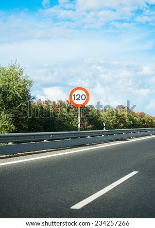 Empty asphalt road with speed limit sign. - stock photo