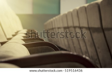 Empty auditorium with beige chairs - theatre or conference hall
