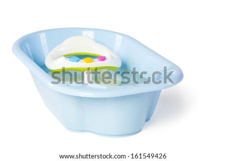 Empty baby bath with water in studio - stock photo