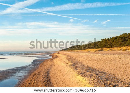 Empty Baltic sea shore in Saulkrasti, Latvia. Vibrant multicolored outdoors horizontal image - stock photo