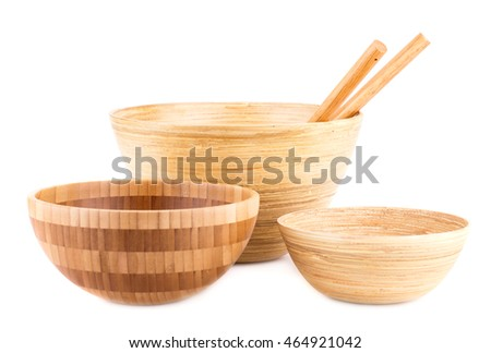 Empty bamboo bowls and wooden spoons  isolated on white background.