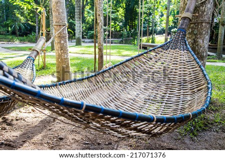 Empty bamboo hammock in the garden