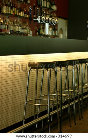 Empty bar waiting for the first costumers - stock photo